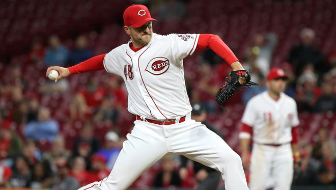 Cincinnati Reds relief pitcher Jared Hughes (48) delivers in the eighth inning during a National League baseball game between the Milwaukee Brewers and the Cincinnati Reds, Monday, April 30, 2018, at Great American Ball Park in Cincinnati. Milwaukee won 6-5.