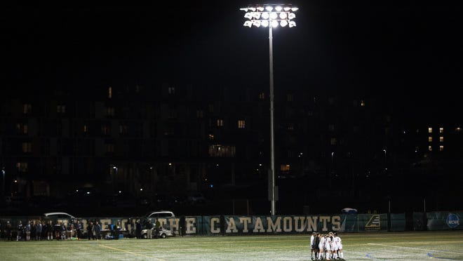 The Vermont Catamounts huddle before their America East women's soccer quarterfinal against UMBC at Virtue Field last October. Brian Jenkins/UVM Athletics