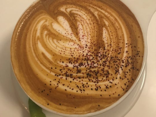 A heart etched in velvety, steamed milk crown the spiced
