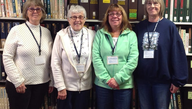 Manitowoc Public Library volunteers, from left: Barb, Kathy P., Sue and Paulette.