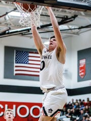 Pewaukee senior Grant Basile (0) breaks free for a slam dunk during the game at home against West Allis Central on Friday, Feb. 2, 2018.