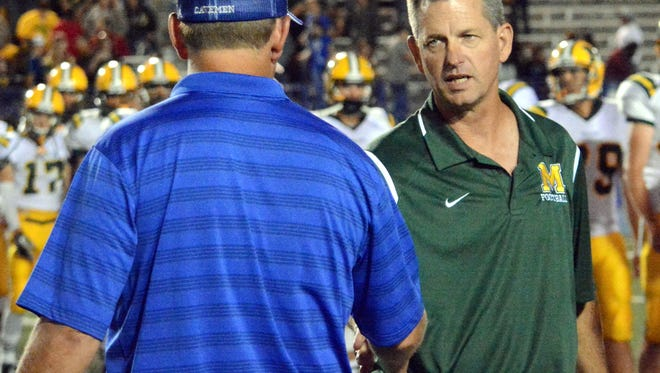 Coaches Gary Bradley (Carlsbad) and Michael Bradley (Mayfield) shake hands after the game Friday, Sept. 11. The Bradley brothers will coach in the same district in 2016-2017.