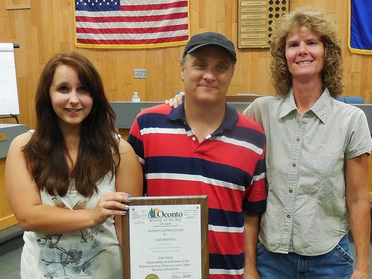 From left, Tessah Dolata, her father Jerry Dolata and Jodi Bostedt were recognized at the Aug. 19 City Council meeting for their work on cleaning up the embankment along the Oconto River behind the new fence along Brazeau Avenue. A fourth person who assisted, Mike Burkowski, is not pictured.