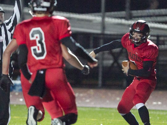 Pinckney quarterback Jack Wurzer celebrates his 1-yard touchdown run in the first quarter of a 24-23 playoff loss to Livonia Churchill.