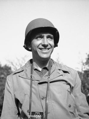 Associated Press photographer George Bede Irvin is shown in England, May 17, 1944. The Associated Press staff photographer was killed on July 25 near Pont Hebert in Normandy while on assignment with the Ninth Air Force.