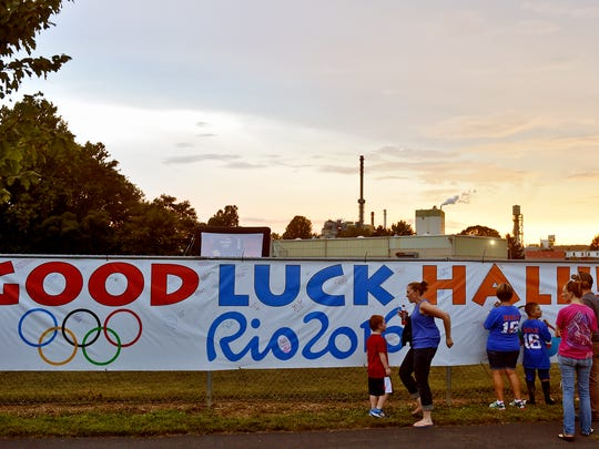 People sign a banner wishing Spring Grove native Hali Flickinger luck Wednesday, Aug. 10, 2016, before Flickinger's 200-meter butterfly final in the Rio Olympics. Friends, family and community members gathered in Spring Grove Community Park to watch Flickinger, who was seeded sixth in the final, compete.