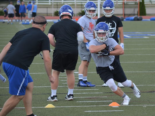 Harper Creek player goes through drills during an early season practice.
