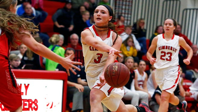 Frankie Wurtz of Kimberly threads a pass against Hortonville during a game on Dec. 23. Wurtz injured her knee later in the game and is out for the season.