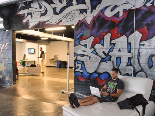 Tim Berzins, head of research and development with The Better Foundation, works at Groundswell Startups, a repurposed indoor skate park, in this 2017 file photo.
