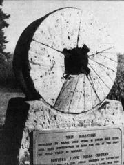 This millstone, one of the first to grind wheat in Montana, sits in front of the Montana Flour Mills building.