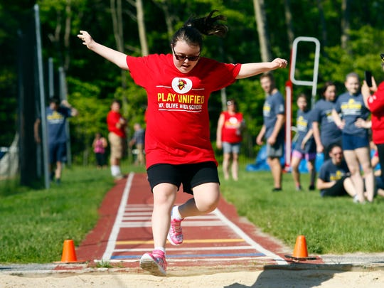 Kaitlyn Bailey of Mt Olive competes in the long jump during the NJAC Unified track and field meet at Jefferson Township High School . May 24, 2018. Randolph, NJ
