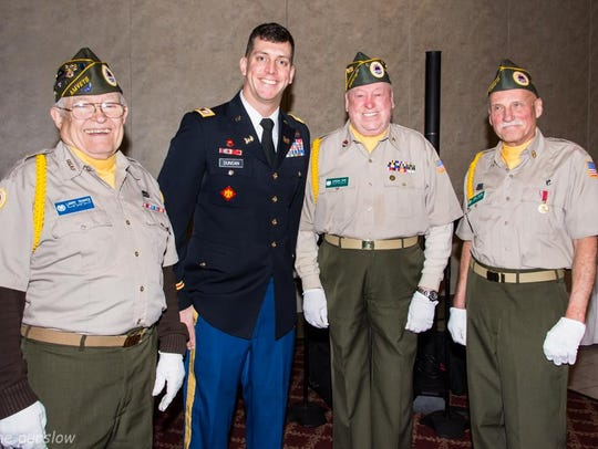 Huron Valley AMVETS Post 2006 Color Guard members who
