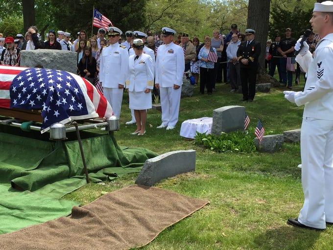 Petty Officer Glenn Berry speaks Saturday during military