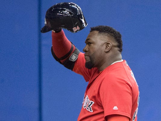 Boston Red Sox designated hitter David Ortiz salutes the crowd as he is introduced for his first at-bat against the Toronto Blue Jays, during an exhibition baseball game Friday, April 1, 2016, in Montreal. (Paul Chiasson/The Canadian Press via AP)