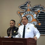 Wayne County Sheriff Benny Napoleon, right, speaks at a news conference in January.