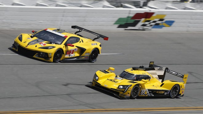 Cars travel around Daytona International Speedway on Saturday during a practice session for the evening's IMSA WeatherTech 240 sports car race.