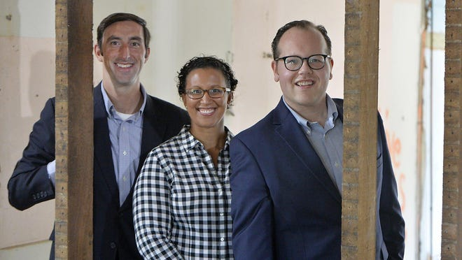 From left, Erie Downtown Development Corporation CEO John Persinger, Vice President of Community Engagement Nicole Reitzell and Vice President of Finance  and Development Matthew Wachter tour EDDC properties on Monday in Erie.