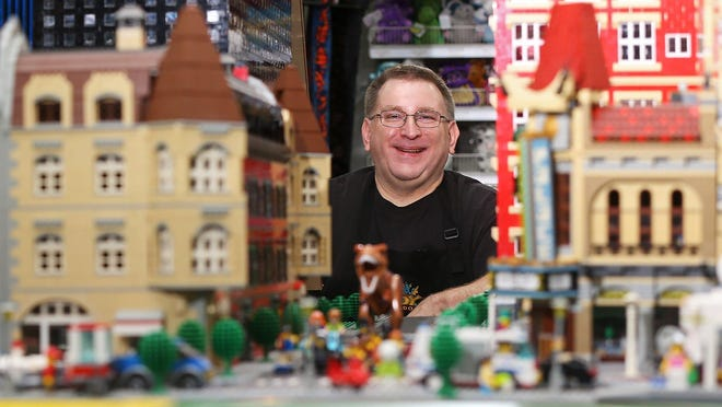 Troy Cefaratti poses for a portrait with one of the large Lego displays at Sir Troy's Toy Kingdom, Wednesday, Sept. 9, 2020, in North Canton, Ohio.