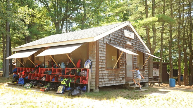 In this Herald News file photo, day campers' backpacks are packed into cubby's on the side of The Nest, a cabin where the younger can children play games indoors at Camp Welch. [Herald News Photo | Jack Foley