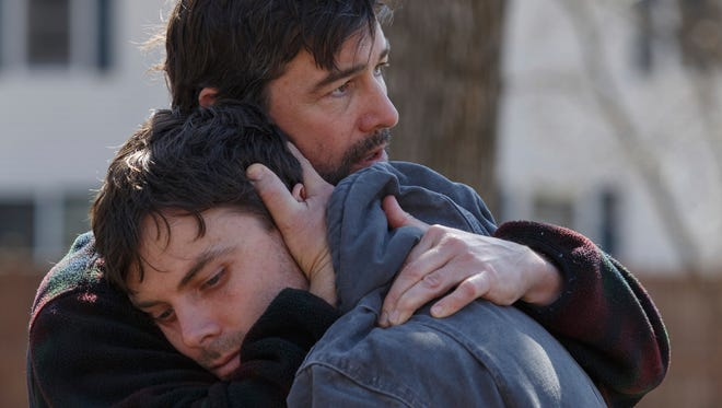 """Joe (Kyle Chandler, rear) comforts Lee (Casey Affleck) in """"Manchester by the Sea."""""""