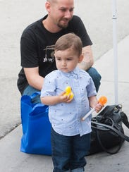 Matthew Roberts (back) and his son, Matthew Roberts