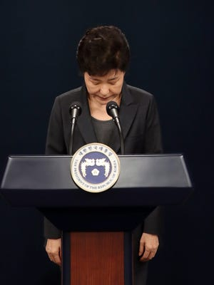 South Korean President Park Geun-hye bows in apology as she delivers an address to the nation at the presidential office Cheong Wa Dae in Seoul, South Korea, Nov. 4, 2016.