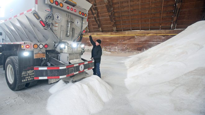 Eder Oliveira adjusts the opening on the back of a salt truck at the Yonkers DPW salt barn on Tuckahoe Road Jan. 20. DPW crews around the Lower Hudson region were loading trucks with road salt in preparation for the next few days of winter weather.