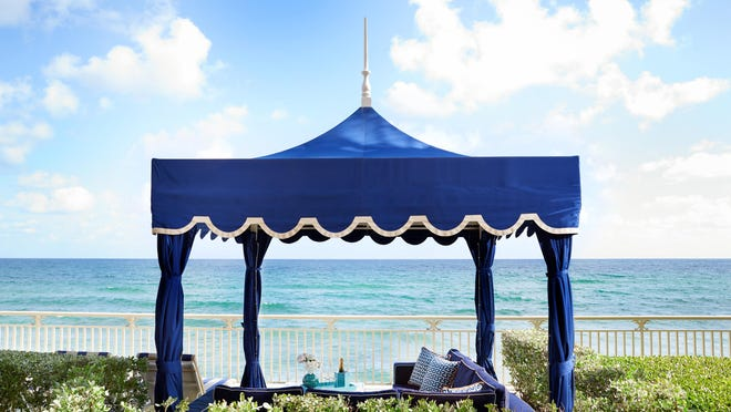 A sweeping ocean view is a key reason why couples enjoy cabana dining at Eau Palm Beach.