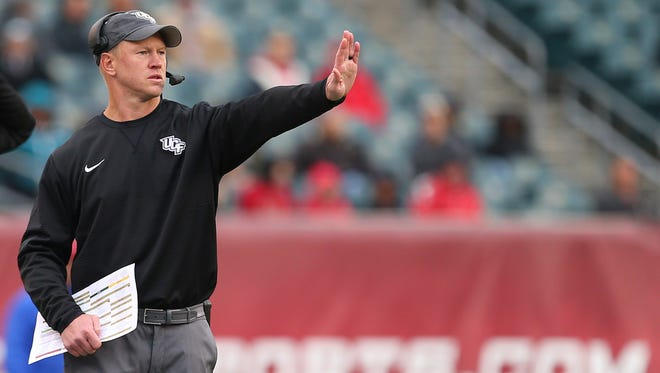 UCF head coach Scott Frost signals to his team during the third quarter against Temple on Saturday in Philadelphia. UCF defeated Temple 45-19.