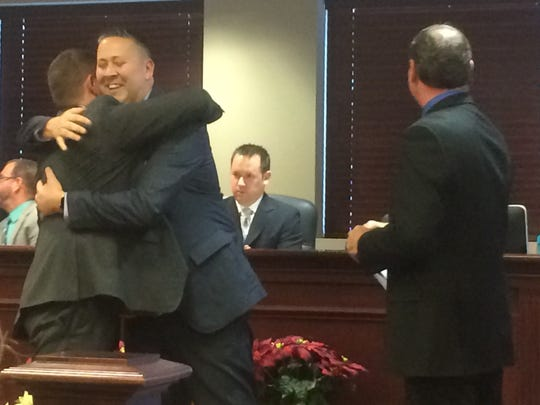 Michael Warren hugs his husband, Christopher, after being sworn in by Assemblyman Tim Eustace as a member of the Rochelle Park Township Committee at its annual reorganization meeting on Saturday, Jan. 7.