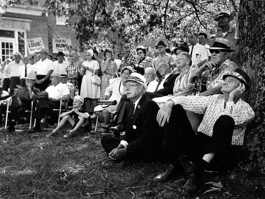 A veteran of mor ethan 50 of the famous Fancy Farm political picnics, J.C. Holland, of Wingo, makes himself comfortable against a tree and listens carefully as office-seekers make their points. Photo published Aug 6, 1967. PUBLICATION PROHIBITED Authority to publish or copy MUST be obtained from Courier-Journal management. To obtain permission call 502-582-4601. 525 W. Broadway, Louisville, KY 40201.