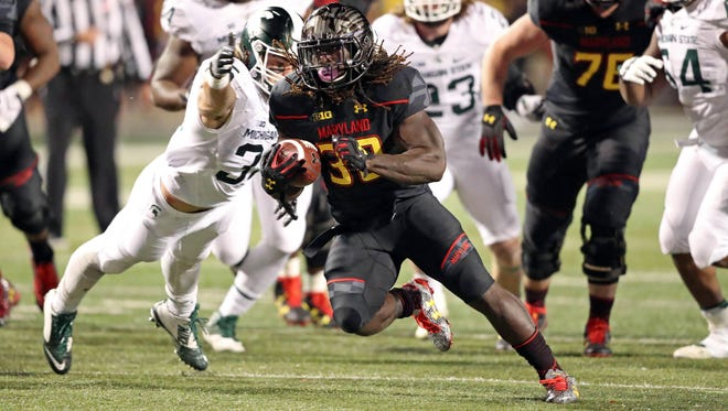 Oct 22, 2016; College Park, MD, USA; Maryland Terrapins running back Kenneth Goins (30) runs the ball in the fourth quarter against the Michigan State Spartans at Byrd Stadium. Mandatory Credit: Mitch Stringer-USA TODAY Sports
