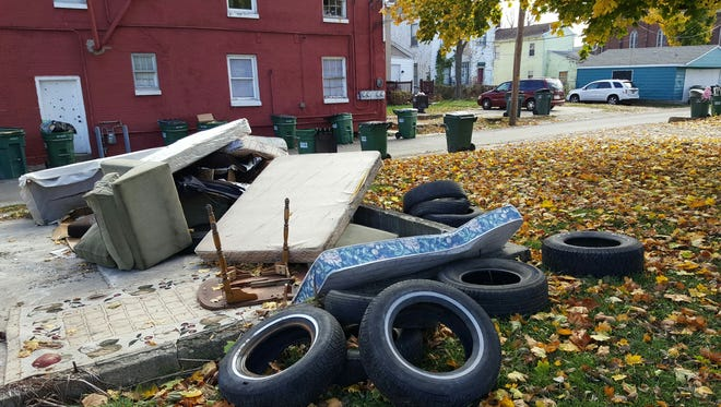 Tires, furniture and more sit next to the North C Street entrance to the alley between North 10th and 11th streets in Richmond.