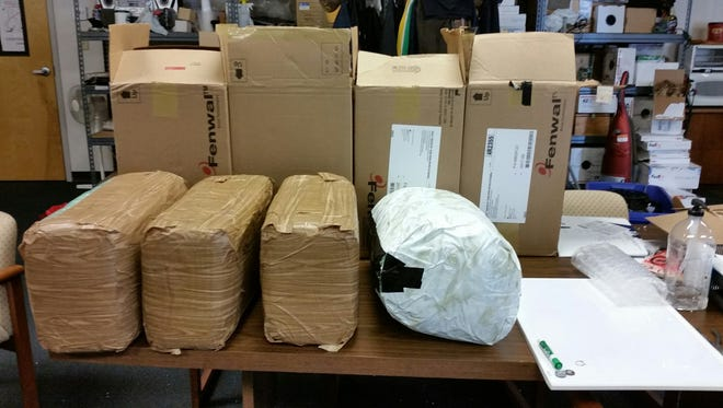 A driver on I-70 was pulled over for a traffic stop, and officers found 100 pounds of marijuana in his car.