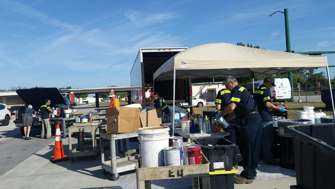 Martin County Solid Waste and Utilities staff unloads and sorts household hazardous waste for proper recycling at the Recycling Roundup.