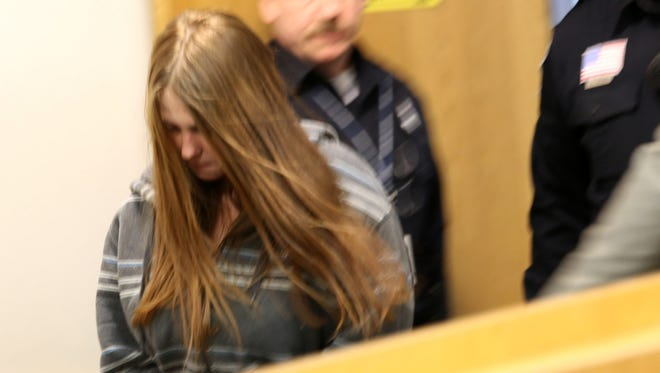Angela Marie Alexie 24, walks in with her head down for her arraignment  at Eastpointe's 38th District Court on Wednesday, January 28, 2015.