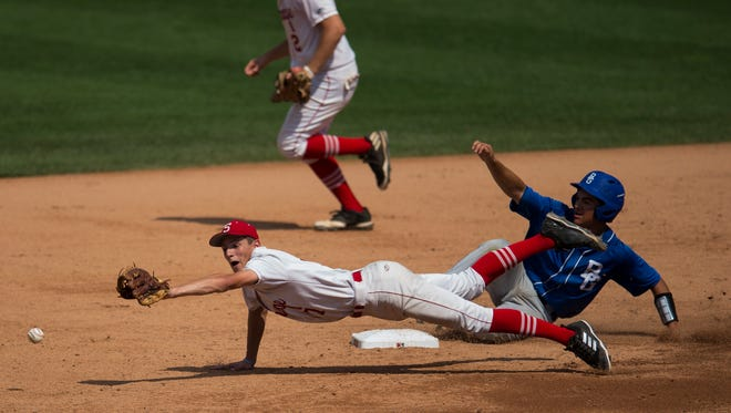Southridge's Colson Montgomery (7) misses an overthrown ball as Boone Grove's Austin LeMar (20) slides safely into second in the Wolves' 5-4 victory in the Class 2A state championship game Saturday at Victory Field.
