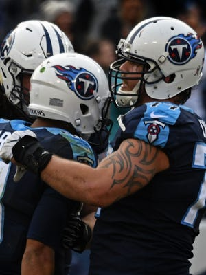 Titans offensive tackle Taylor Lewan (77) pats quarterback Marcus Mariota (8) on the shoulder after he threw a touchdown with less than one minute left on the clock in the fourth quarter at Nissan Stadium on Sunday, November 12, 2017 in Nashville, Tenn.