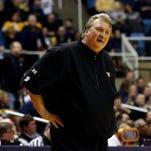 West Virginia Mountaineers head coach Bob Huggins reacts from the bench.
