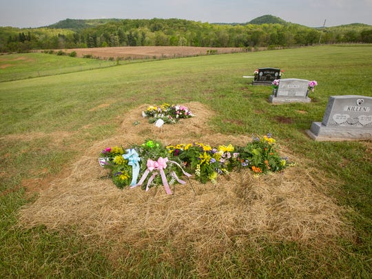 May 4, 2016: The graves of Frankie, Hanna, Christopher Jr., and their parents Christopher Sr. and Dana the morning after their burial at Scioto Burial Park in McDermott.