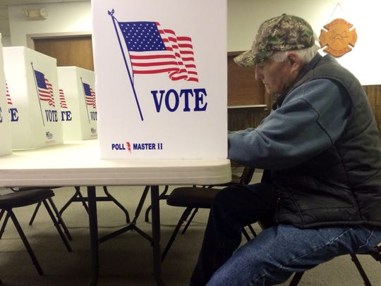 Charles Thompson, 80, was the first voter to the polls