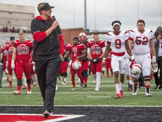 Western Kentucky coach Mike Sanford talks to the crowd during halftime of the team's spring game.