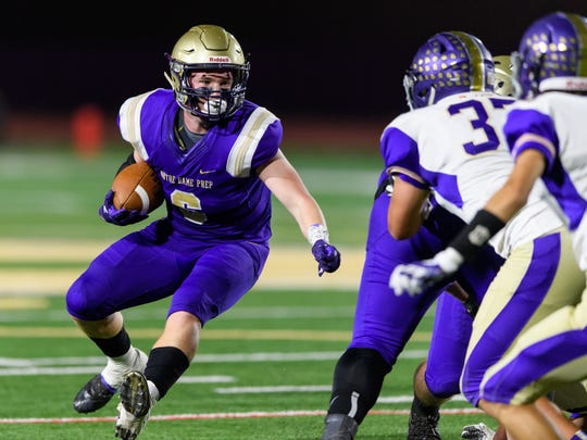 Notre Dame Prep's Cole Fisher (#6) rushes in the first