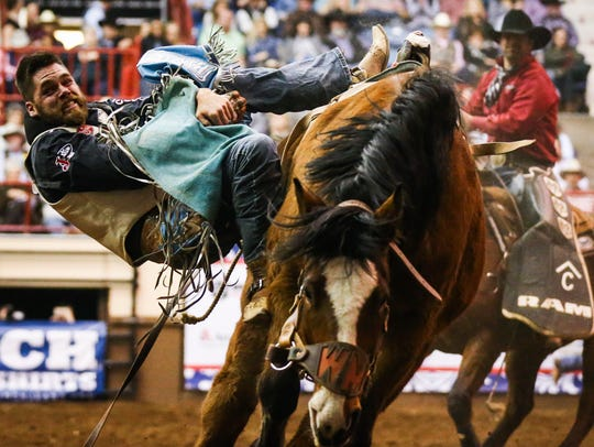 Luke Creasy rides bareback during the Cinch Chute-Out on Saturday, Feb. 17, 2018, at Foster Communications Coliseum.