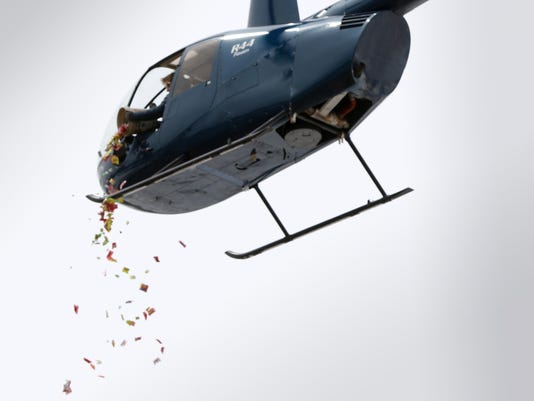 Helecopter drops candy at Spring Creek Church celebration