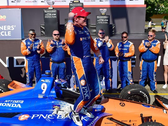 Scott Dixon celebrates after winning the Honda Indy Toronto IndyCar race on July 15.
