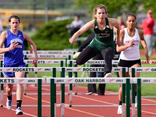 Oak Harbor's Alexa Weis wins the girls 100 meter hurdles with a time of 16.1 seconds.
