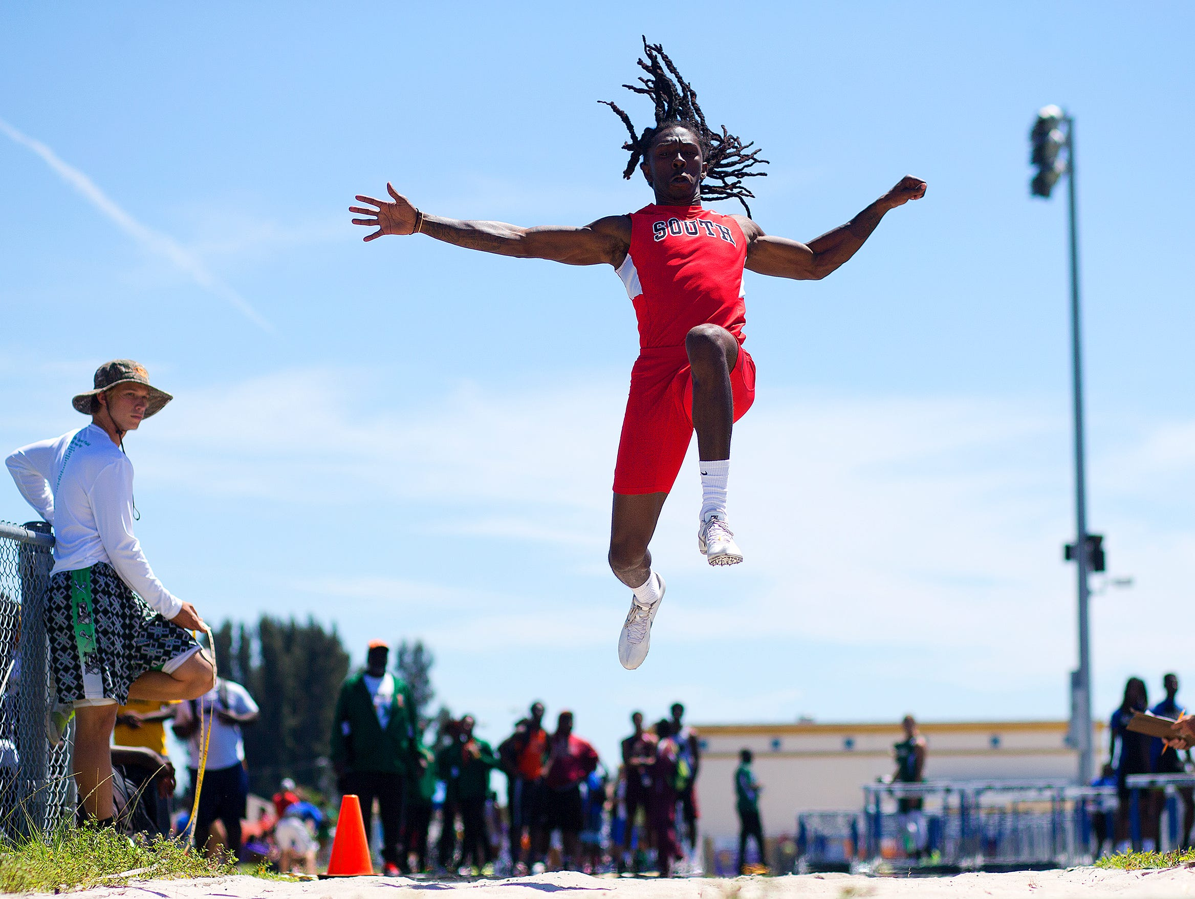 South Fort Myers High School's Willie Johnson competes Saturday in the long jump of the LCAC Track and Field Championships at Ida Baker High School in Cape Coral. Johnson won the event.