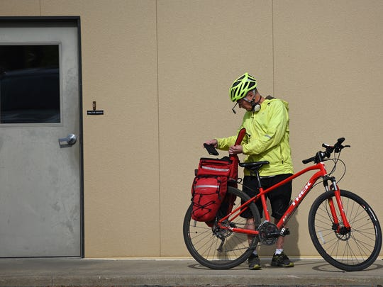 Dave Wiese gets ready to ride his bike home from work,