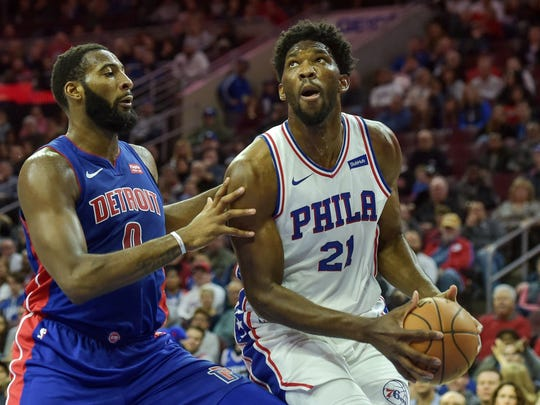 76ers center Joel Embiid looks to shoot as Pistons